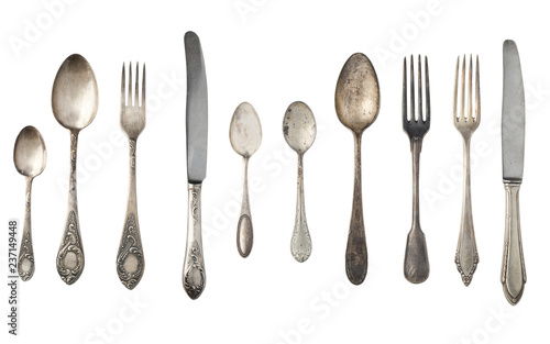 Fotografie, Obraz  Vintage spoons, forks and knives isolated on a white background