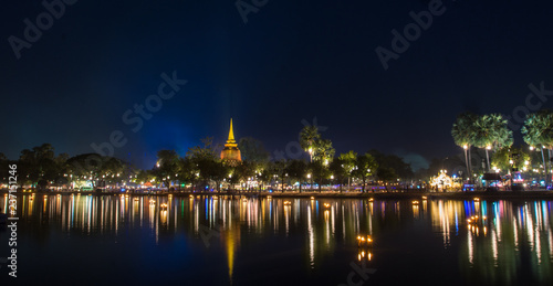 Fotografie, Obraz Sukhothai historical park  at night with lighting in Loy Krathong Festival