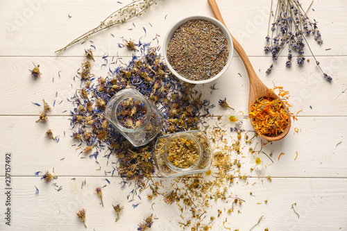 Canvas Prints Spices Dried flowers and herbs on white wooden table