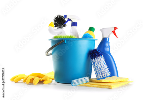 Foto Bucket with cleaning supplies on white background