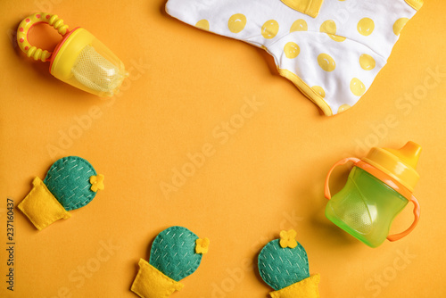 Fotografia, Obraz  Frame made of baby clothes and accessories on color background, flat lay