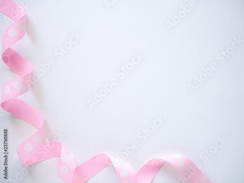 Fototapeta Pink curly ribbon on a  white obraz na płótnie