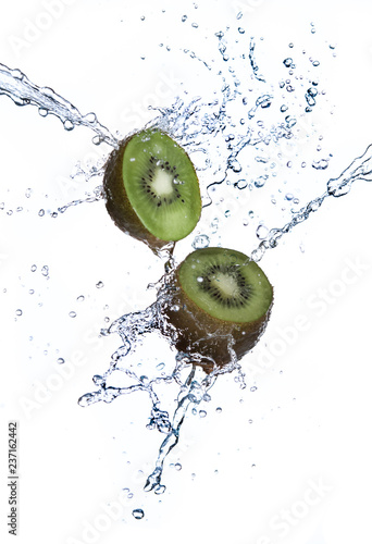 Kiwi fruit with water splash flying in the air isolated on white background