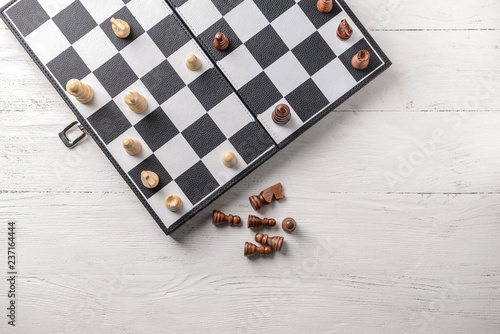 Fényképezés Game board with chess pieces on white wooden table