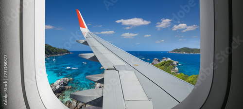 Foto auf Gartenposter Rosa dunkel View from airplane. Flight window. Vacation destinations. Tropical beach. Travel concept.