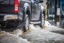 Pickup Truck On A Flooded Stre...