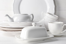 Set Of Clean Dishware On White...