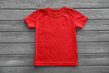 Blank Red T-shirt On Wooden Background