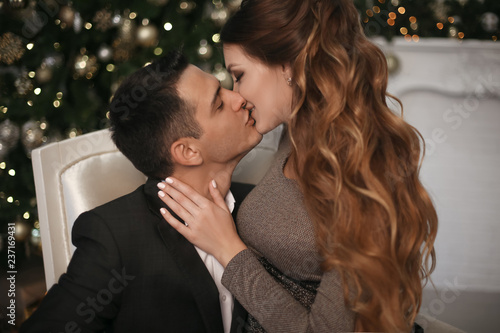 Fotografie, Obraz  Close-up of young romantic couple is kissing at home