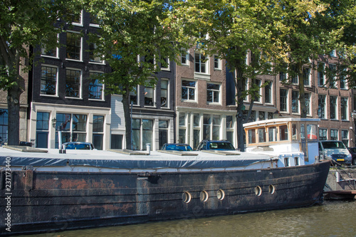 Photo  Canals from Amsterdam seen from the water