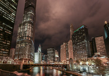 Skyline At Night With Water In The Foreground. Chicago, USA
