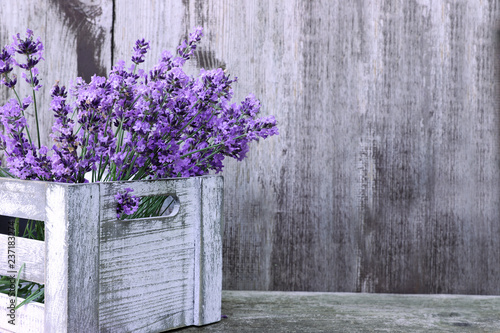 Fotobehang Lavendel Lavender flowers in box on wooden background