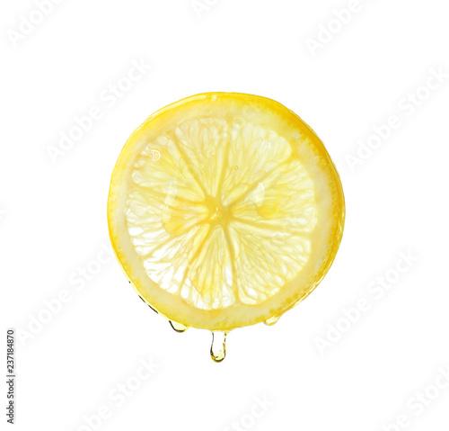 Essential oil dripping from lemon slice on white background Fototapete