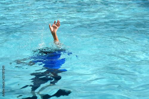 Male boy struggling underwater drowning in swimming pool Fototapeta