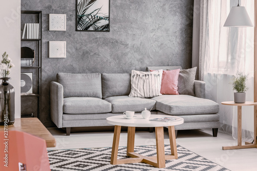 Round coffee table on patterned rug in