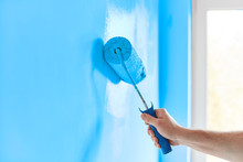 Male Hand Painting Wall With P...
