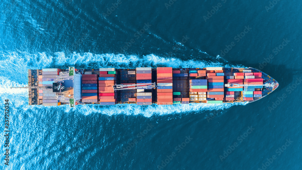 Fototapety, obrazy: Aerial top view full speed container ship in the sea for logistics import export, shipping or transportation concept.