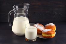 Doughnut And Milk On Dark Boards