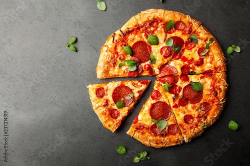 Pizza with salami and chorizo