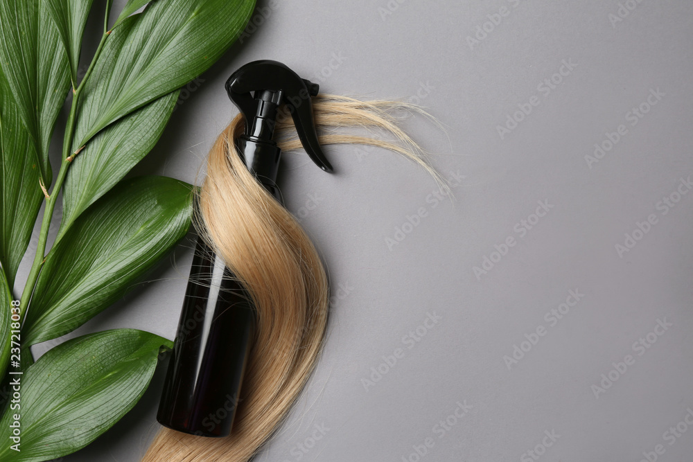 Fototapety, obrazy: Spray bottle with cosmetic for hair on grey background, top view