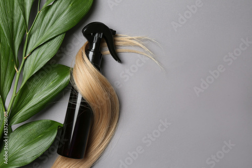 Spray bottle with cosmetic for hair on grey background, top view Tableau sur Toile