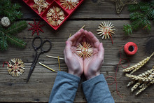 Making Of Handmade Christmas Toys From Straw With Your Own Hands. Children's DIY Concept. Making Xmas Tree Decoration.
