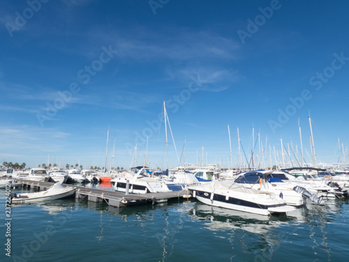 Photo  Sail Boats on a beautiful cloudless day in the marina