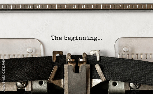 Text The beginning typed on retro typewriter Canvas Print