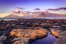 View Of A Cloudy Sunset Over False Bay From Kommetjie Beach, With Beautiful Rocks In The Breaking Waves , Cape Town, South Africa