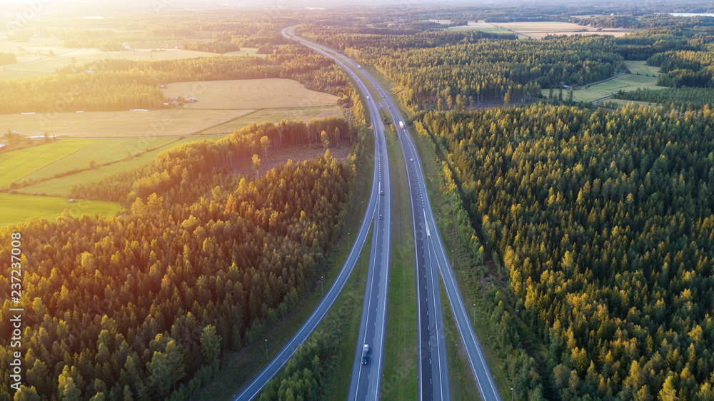 Fototapety, obrazy: Aerial view of road through countryside and cultivated field