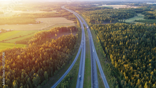 Valokuva  Aerial view of road through countryside and cultivated field