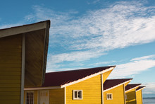 Colorful Yellow Houses Under Blue Sky