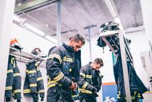 Firemen Preparing For Emergency Service.