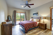 Restful Country Bedroom With Wooden Bed And Dresser