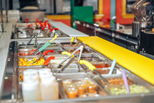 Trays With Food On Showcase At...