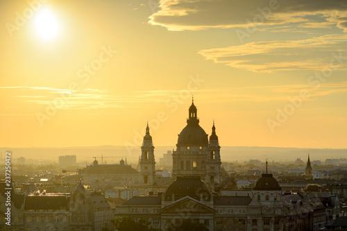 Backlit St. Stephen's Basilica against Budapest skyline Fotobehang