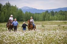 Grandparents Leading Horses Ridden By Grandchildren