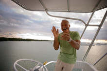 Man Laughing On Boat