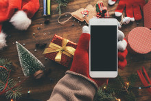 Smartphone In Hand For Christmas Season Mock Up