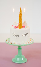 Unicorn Cake With Fondant And Mini Marshmallows On Turquoise Cake Stand
