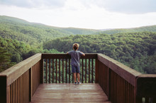 Young Photographer Exploring A Scenic Overlook In Western Maryland