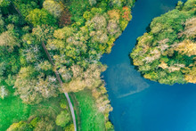 Aerial View Of A Lake In An Autumnal Forest