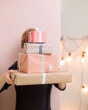 Woman Hiding Behind Boxes