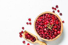 Cranberry In Wooden Bowl On White Background.