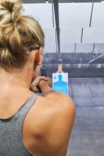 Woman Shoots Gun At Target Practise
