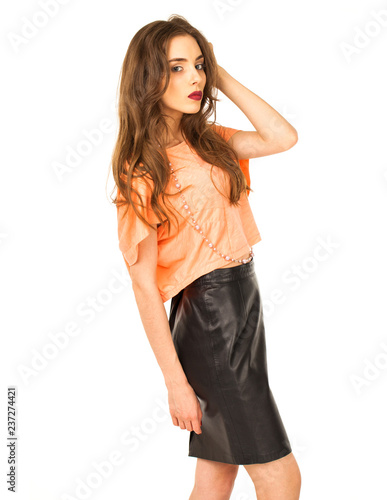 b10b83c0c0b26 Young woman in black leather skirt and orange blouse - Buy this ...