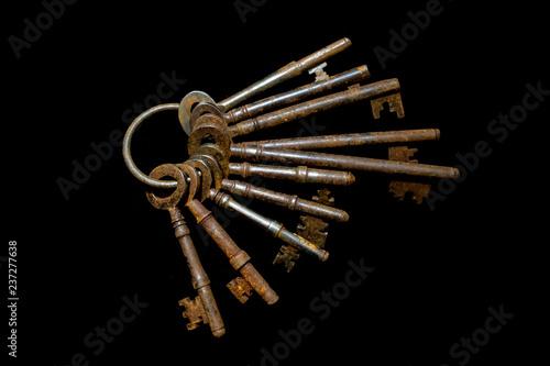 Carta da parati Bunch of Vintage Antique Risty Keys on Black Background