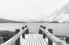 Pedestrian Snowy Footbridge On A Lake