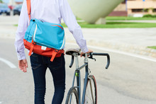 Crop Man With Bike And Bag