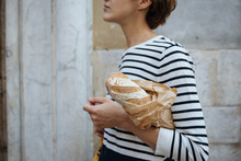 Unidentified Person Holding French Baget Bread